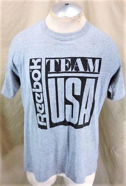 c18a6acd1f VINTAGE 90'S REEBOK TEAM USA (LARGE) RETRO OLYMPIC GAMES GRAPHIC T-SHIRT  GREY