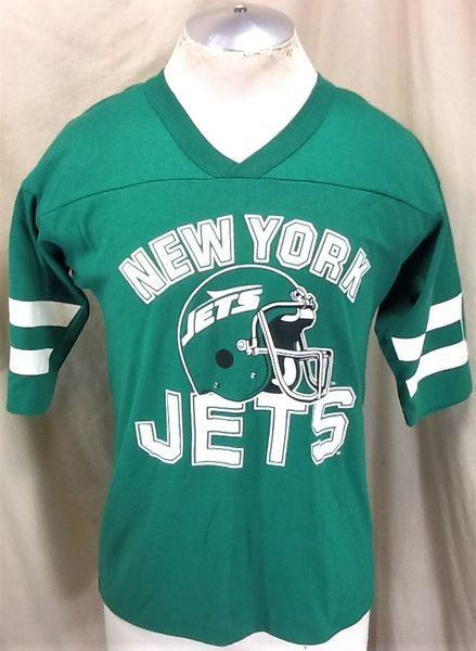 9a937206cd353 VINTAGE 90'S NEW YORK JETS FOOTBALL (MEDIUM) NFL HELMET GRAPHIC T-SHIRT.  Related Items