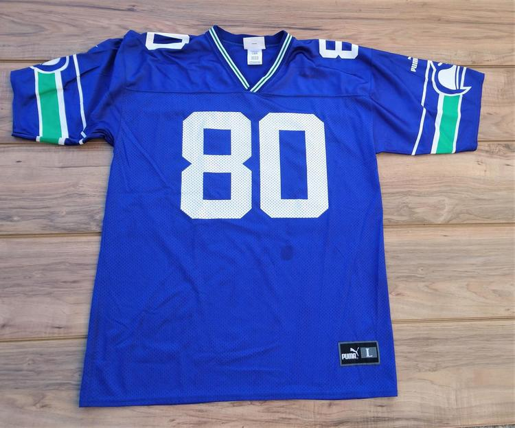 outlet store 9ce0a 47556 Puma Seattle Seahawks Steve Largent Throwback NFL Jersey Size Large | SOLD  | Football Apparel | SidelineSwap
