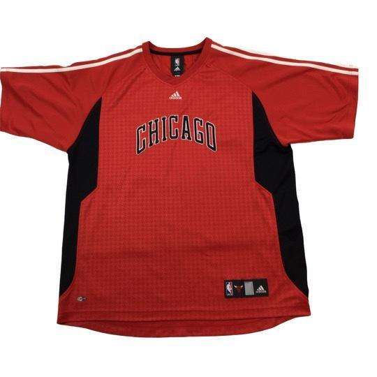 Adidas NBA Chicago Bulls warm-up jersey. Stitched logo and lettering.