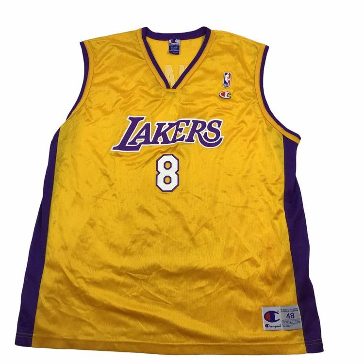 Vintage Los Angeles Lakers Kobe Bryant #8 Champion jersey. Tagged an XL.
