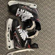 Used CCM FT470 size 4 hockey skates w/ 2 extra sets of steel